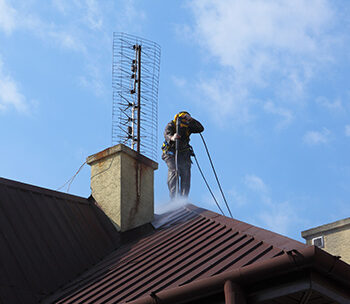 commercially pressure washing a roof