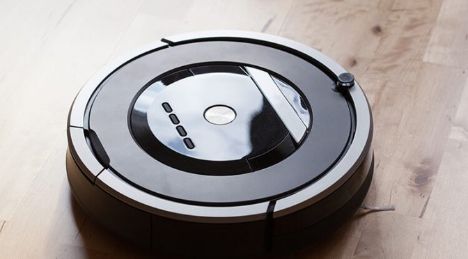Robotic vacuum cleaner on wooden floor